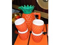 1970's vintage plastic pineapple drinks jug and four cups set.