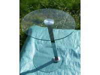 SMALL STYLISH GLASS CIRCULAR SIDE COFFEE OR DRINKS TABLE OR MINI BAR WITH ANGLED CHROME LEG