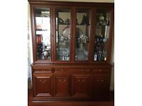 Mahogany two piece side board and display cabinet.