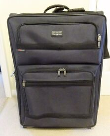 Men's large black two-wheel trolley suitcase.