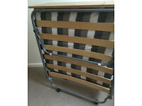 Sturdy folding single guest bed with headboard
