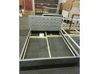 A brand new silver velvet king size bed frame.