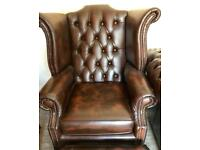 Antique brown chesterfield Queen Anne wing chair and foot stool