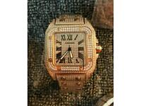 Cartier Santos iced out diamond watch