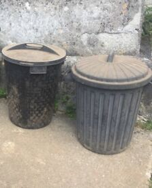 2x black rubbish/storage bins