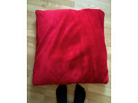 Huge red faux fur type fabric floor cushion from Ikea
