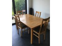 Ikea solid wood extending table and 4 chairs