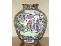 Chinese famille-rose vase painted in vibrant colours and gilded