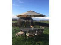 Beautiful table and 6 chairs cushions and umbrella