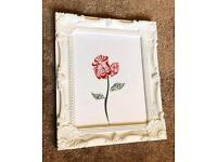 Arabic calligraphy encased in a beautiful white vintage frame