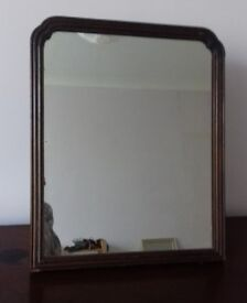 Beautiful vintage mirror set in dark wood surround, self standing wood support at back