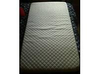 Toddler bed mattress and mattress proctor