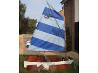 Sailing Dinghy Optimist. Wooden hull and spars. Sail, foils. Detachable seats for rowing