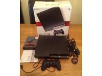 PlayStation 3, boxed, controller and Games