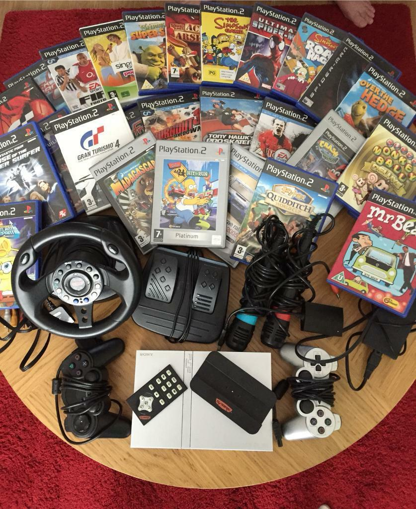 PlayStation 2 with accessoriesin Caerphilly - Silver PlayStation 2 along with sabre steering wheel and peddles, 2 controllers, singstar microphones and adapter with a range of 28 games.PlayStation 2 with steering wheel, peddles, singstar microphones and adapter £120Games alone £30Everything...