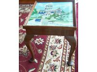 Unique coffee table with beautiful embroidery under glass.