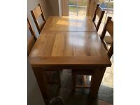 George Street Furnishers Solid oak table & chairs,