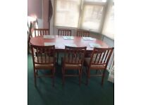 Very large extendable dining table and 6 chairs