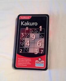 KAKURO GAME IN A TIN IN UNUSED CONDITION. ONE TO FOUR PLAYERS WITH FOUR LEVELS.