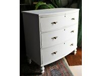 Chest of drawers. Traditional bow-fronted, solid wood, brass handles. Painted white. KT22.
