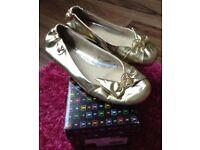 Gold playboy flat shoes