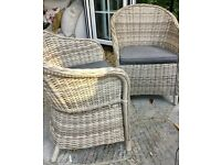 Two Grey wicker garden chairs with cushions