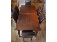 Solid Wood Table, 180 -90 cm {5 ft 9, + 3} 6 matching chairs in Brown leatherette .