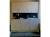 Kitchen: White gloss, soft close doors, x3 overhead cupboards, sink, integrated dishwasher + fridge