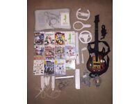 Nintendo Wii Bundle (Console, 12 games, WiiFit, Guitar Hero, Mario Kart + more!)