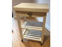 White wooden butcher's block, on wheels, with shelves and drawer. Excellent condition