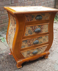 Small pressed pine and fabric chest of drawers.
