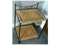 Two solid metal framed wicker side tables.