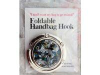 FOLDABLE HANDBAG HOOK - BRAND NEW IN PACKET
