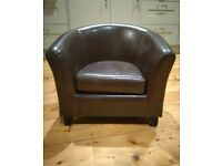 Child's faux leather tub chair and footstool
