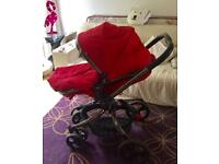 Red Mothercare Orb Pram and Pushchair with Raincover and Travel Adaptors