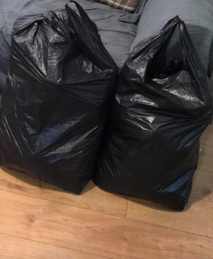 2 huge black bags full of baby boys