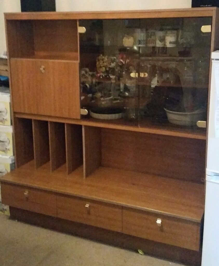 mahogany affect wall unit with 2 glass display doors a desk and 3 draws nice condition