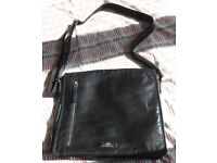 Good quality black leather satchel-style women's bag.