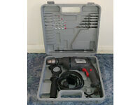 Hammer Drill with case and 2 sets of drill bits