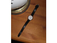 Water resistant quartz woman's Watch. Lovely thing. Just had a new battery fitted. Keeps time great.