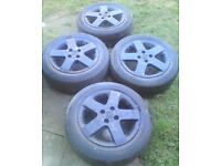 15 INCH MATT BLACK 5 SPOKE ALLOY WHEELS VAUXHALL CORSA ALLOY ALLOYS WHEELS 4 STUD WILL FIT OTHERS