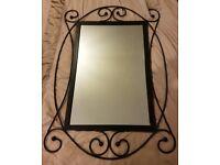 Black metal ornate mirror