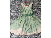 Brand new with tags mint green 50s vintage style prom dress with petticoat lining, size 10