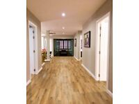 Wood and laminate floor layers