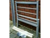 single bed, grey colour, metal frame, wooden slats. In very good condition.