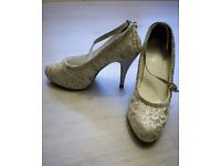 Bridal shoes (heels) with white lace, gem embellishments and glittered heels