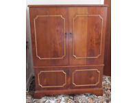 Solid wood TV stand. Very nice quality. H: 41¾ in , W: 31½ in, D: 18½ in.