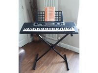 Yamaha. Portable Electric Keyboard. YPT-210. Very good condition.