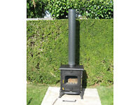 Clarke Buckingham cast iron wood burning stove with 1m flue pipe. Little used woodburning stove.