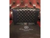 CHANEL Flap over quilted bag.